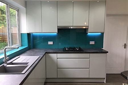 high gloss light grey modern contemporary kitchen room by roomworking to accommodate two internal doors this design maximises storage and space without compromise