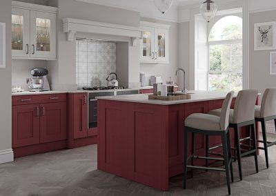 Image of a traditional kitchen design with red kitchen units.