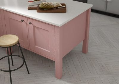 A close up image of a pink kitchen island unit from the Solva kitchen range.