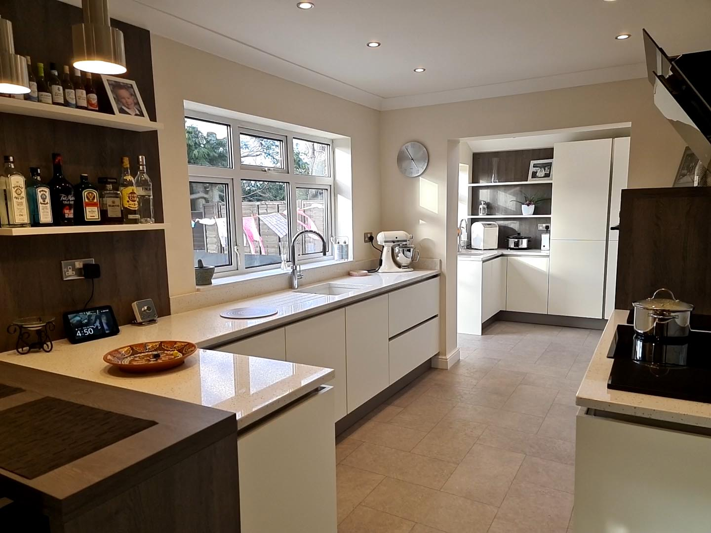 An image of a white marble kitchen utilising the space available