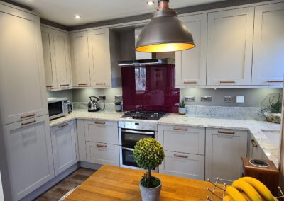 A traditional grey kitchen with a hint of colour