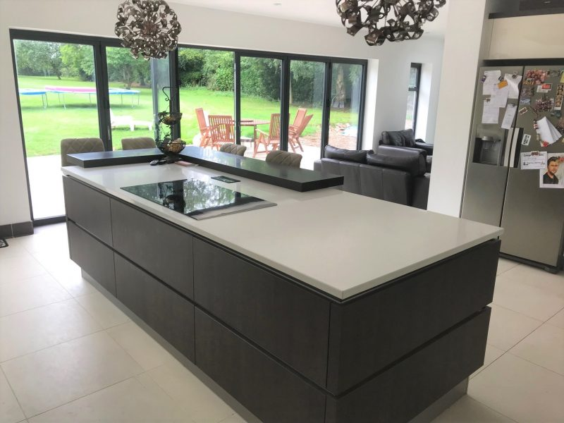 Image of the oak kitchen island with a quartz worktop.
